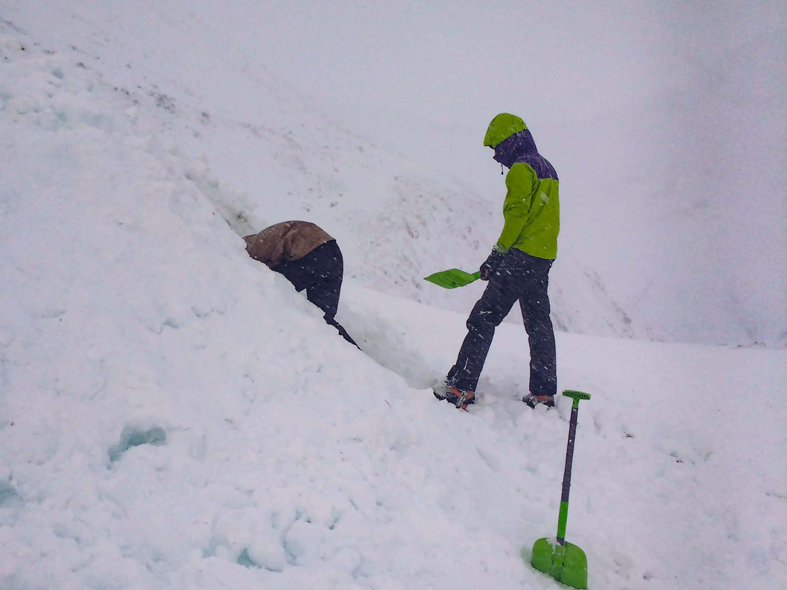 Digging a snow shelter